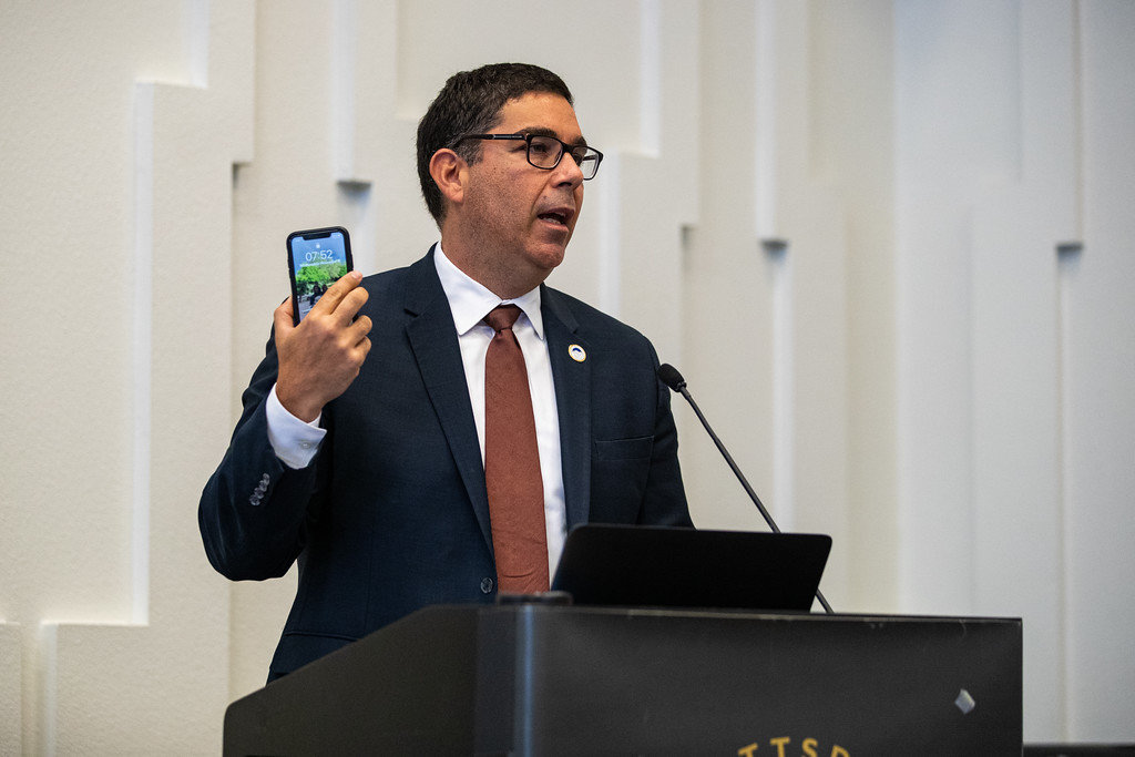 Town of Paradise Valley Mayor Jerry Bien-Willner holds up his phone as he discusses how readily accessible short term rentals are in his municipality.