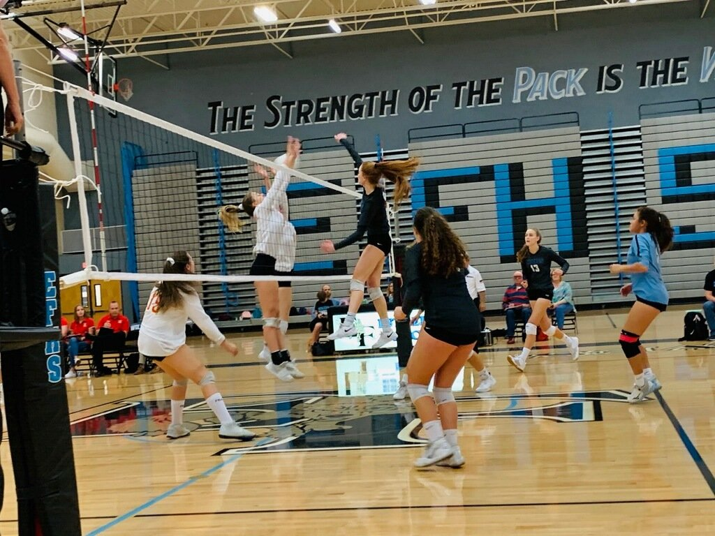 Estrella Foothills senior middle hitter Makayla Hurles hits a kill through the Chandler Seton Catholic block during the 4A volleyball quarterfinals Nov. 7 at Estrella Foothills High School inn Goodyear.