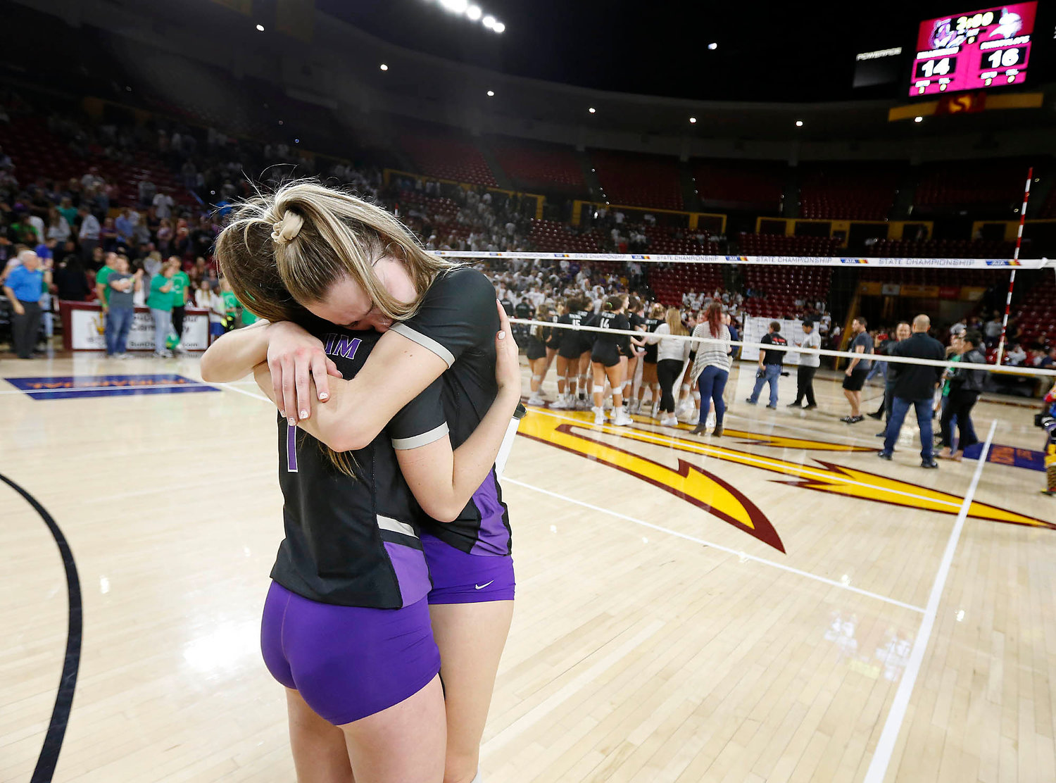 Millennium junior outside hitter Jordan Miller, right, is consoled by junior defensive specialist Calli Johnson following the Tigers five-set loss to Sunnyslope in the girls 5A state volleyball championship at Desert Financial  Arena on Tuesday, Nov. 12.