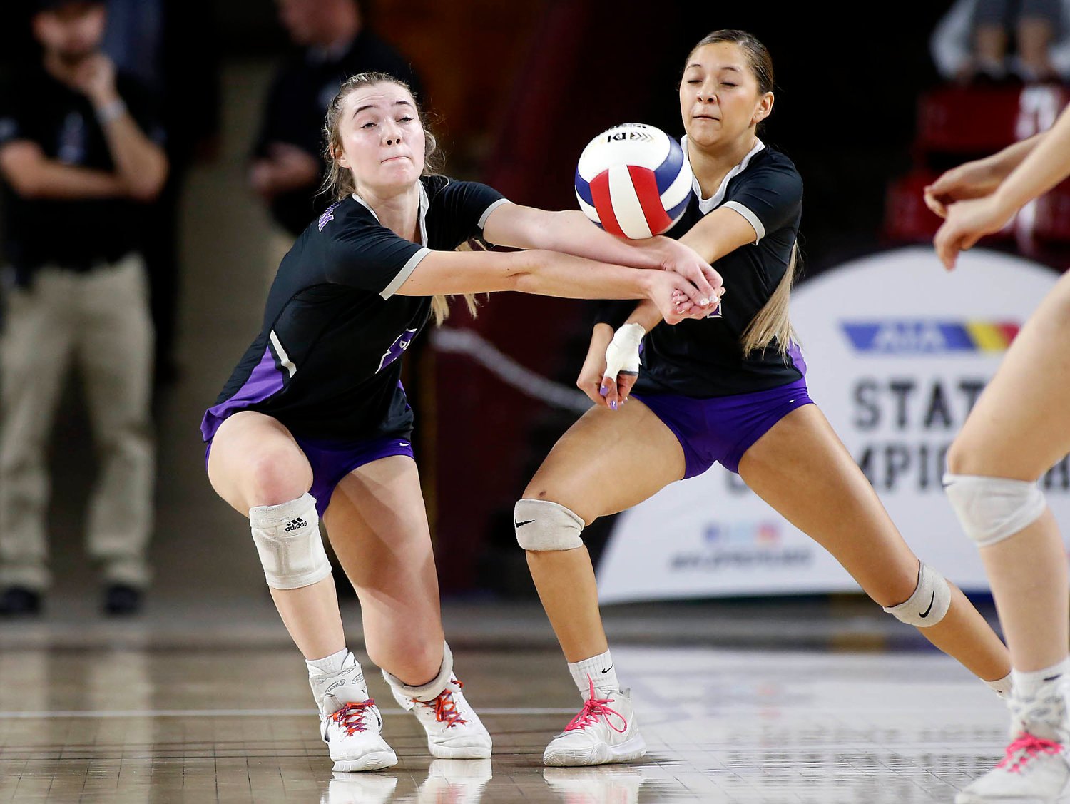 Millennium junior Jordan Miller, left, and junior Jocelyn Chavez-Rivas come together as they try to dig the ball during the girl's 5A state volleyball championship against Sunnyslope at Desert Financial Arena on Tuesday, Nov. 12 in Tempe.