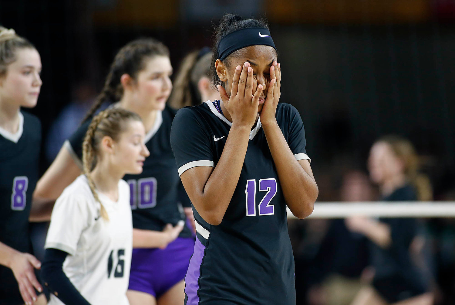 Millennium freshman outside hitter Eryn Jones (12) reacts after losing to Sunnyslope's during the girls 5A state volleyball championship on the ASU campus in Tempe on Tuesday, Nov. 12.