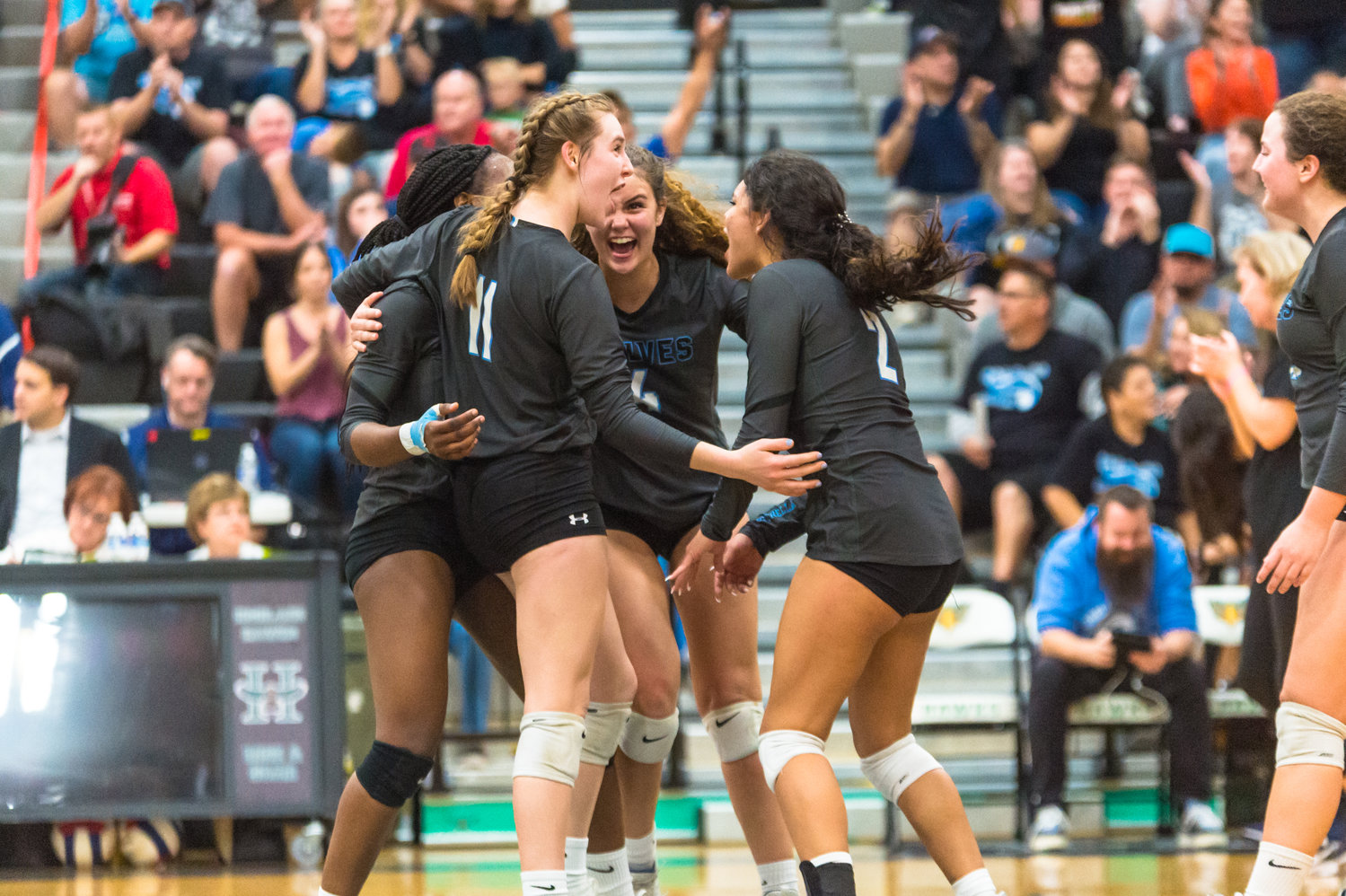 Estrella Foothills sophomore Emma Barber (#11), junior Tessa Kamarata (#2), junior Nayeli Mancilla (#4) and senior Aniya Mitchell celebrate a point during the Wolves' late match surge in the 4A state girls volleyball final Nov. 13 at Highland High School in Gilbert.