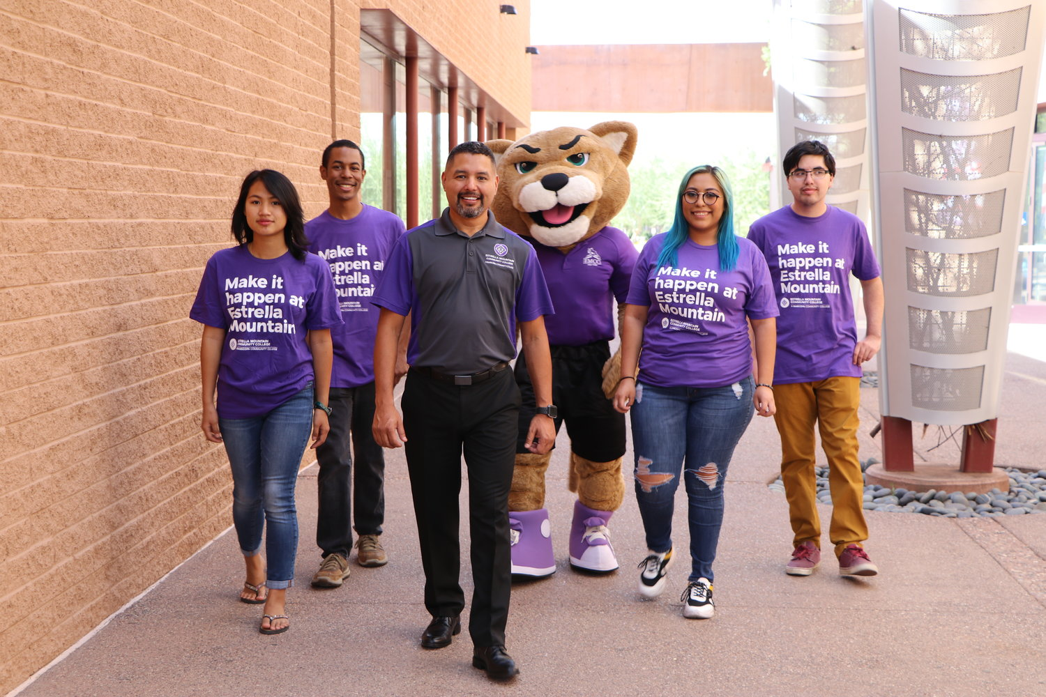 Estrella Mountain Community College president Dr. Rey Rivera poses for a photo with EMCC students and the school mascot, Roary the Estrella Mountain Lion. [Submitted photo]