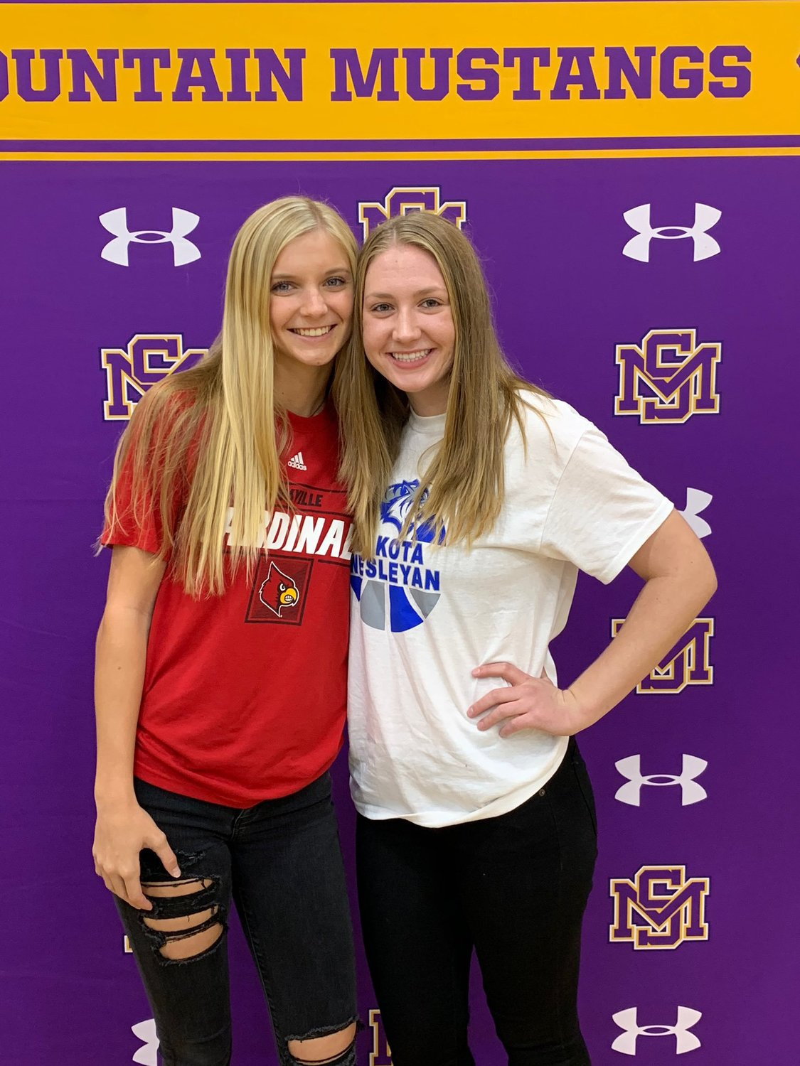 Sunrise Mountain seniors Sydney Bickel, Left, and Teryn Demaree signed to continue their athletic careers in college during a ceremony Nov. 12 at the Peoria school. Bickel signed to play softball at the University of Louisville while Demaree will play basketball at Dakota Wesleyan University.