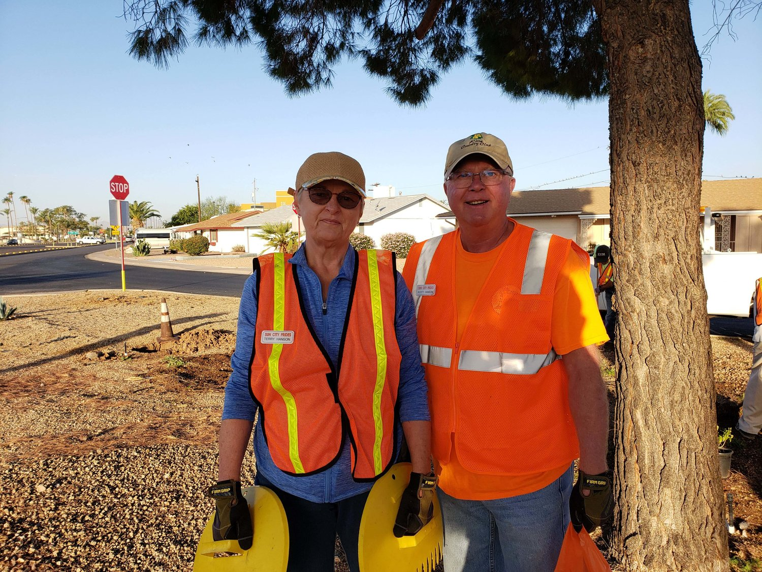 PRIDES volunteers, from left, Terry and Scott Hanson were part of the work detail at PRIDES Park at 105th and Peoria avenues.