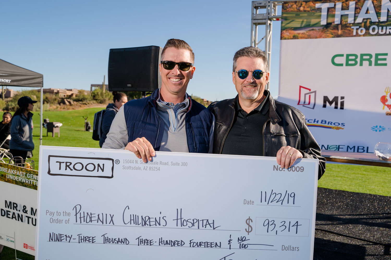 2019 Chair Bryce Terveen accepting the Troon Hit The Green Check from Mitch Harrell, President of Troon Golf