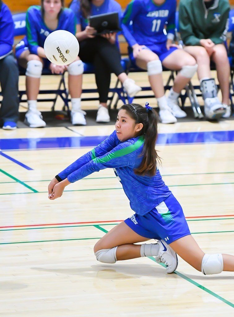 Kaori Robertson dives in for the dig. Miss Robertson earned a spot on the Navajo Times all-star list.