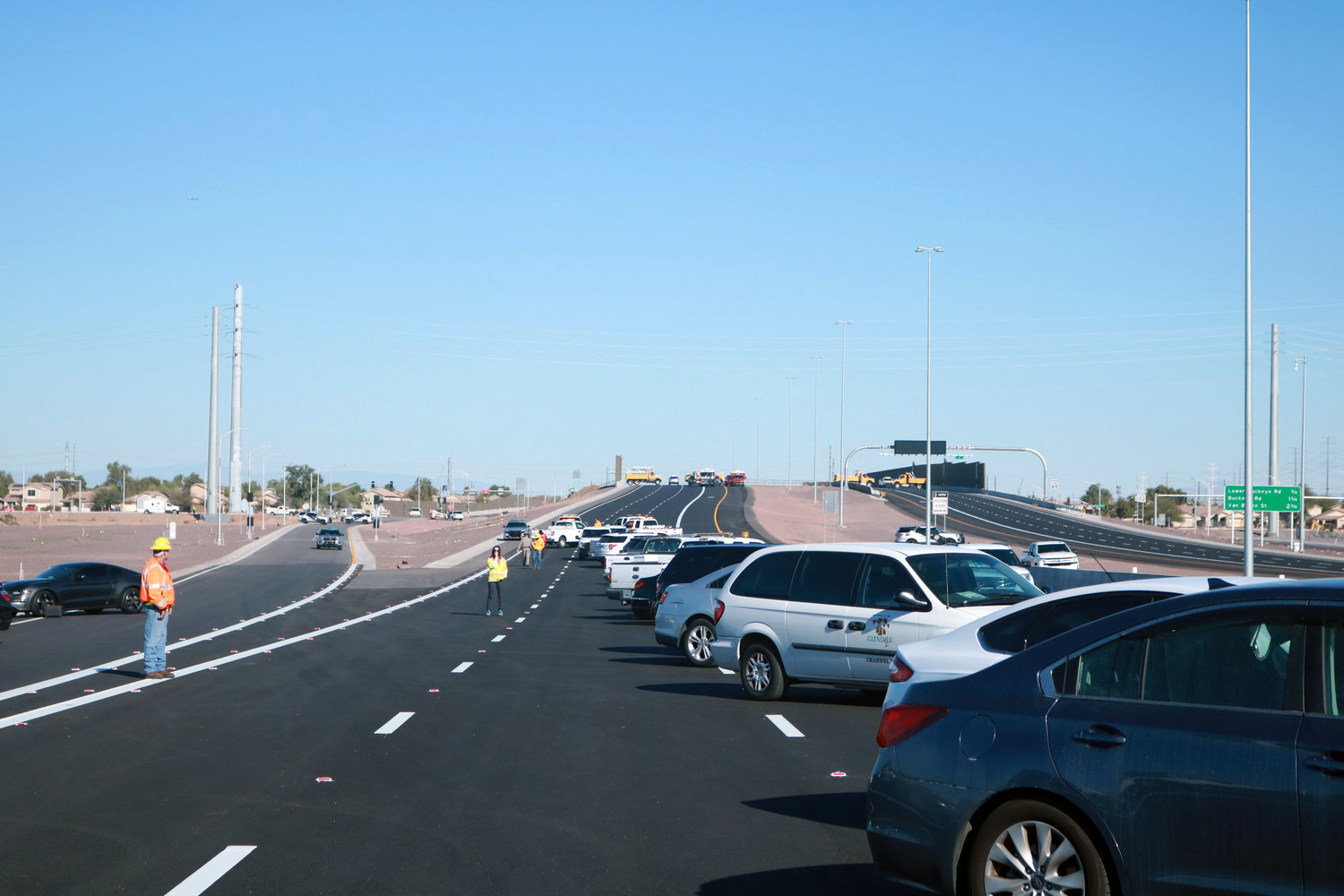 Vehicles are parked along the Loop 202 South Mountain Freeway near Broadway Road on Dec. 18, 2019. Gov. Doug Ducey and other Arizona officials kicked off the impending opening of the $1.7 billion project, which is expected to open by end of 2019.