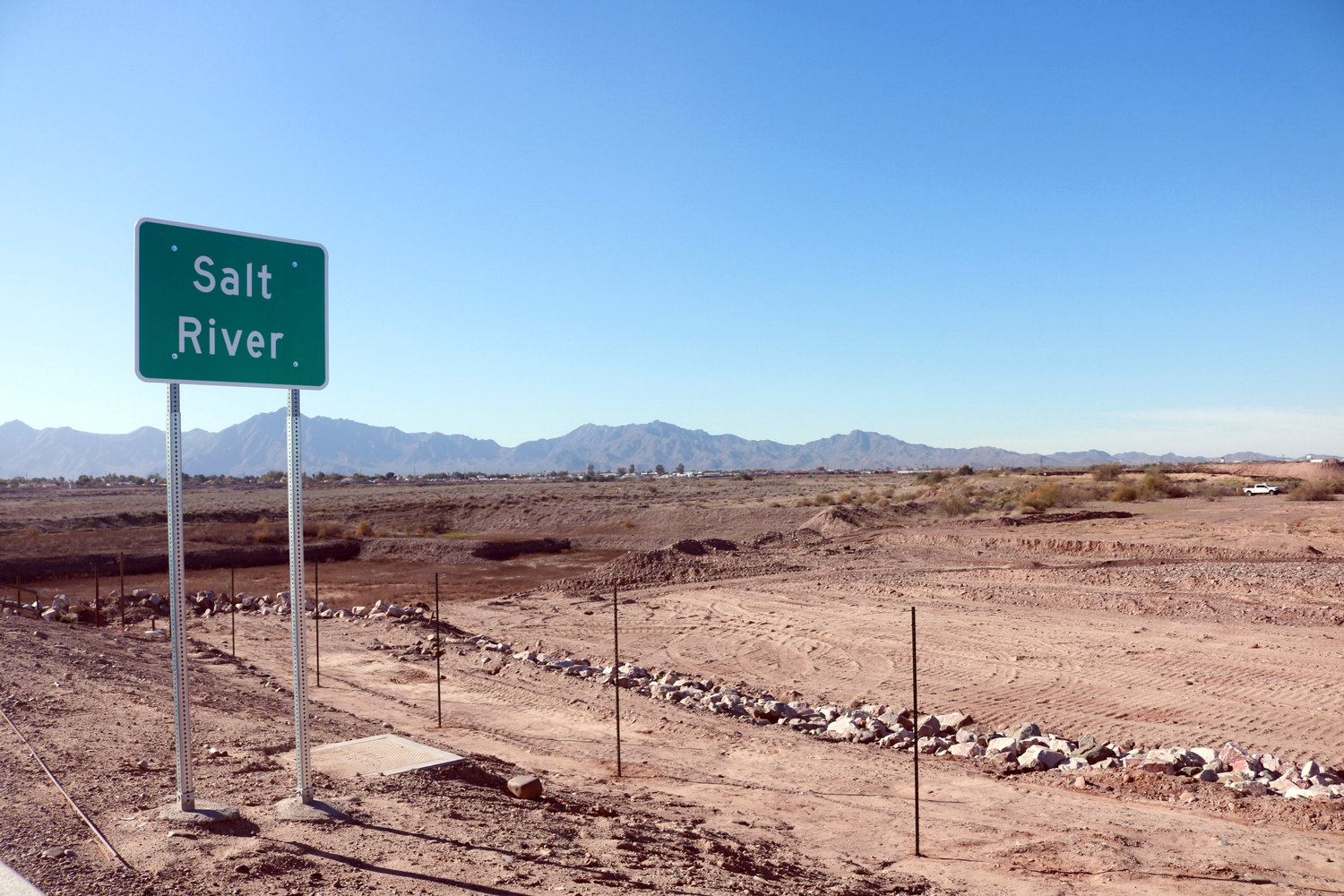 A sign along the Loop 202 South Mountain Freeway indicates the Salt River's presence in the area near Broadway Road.