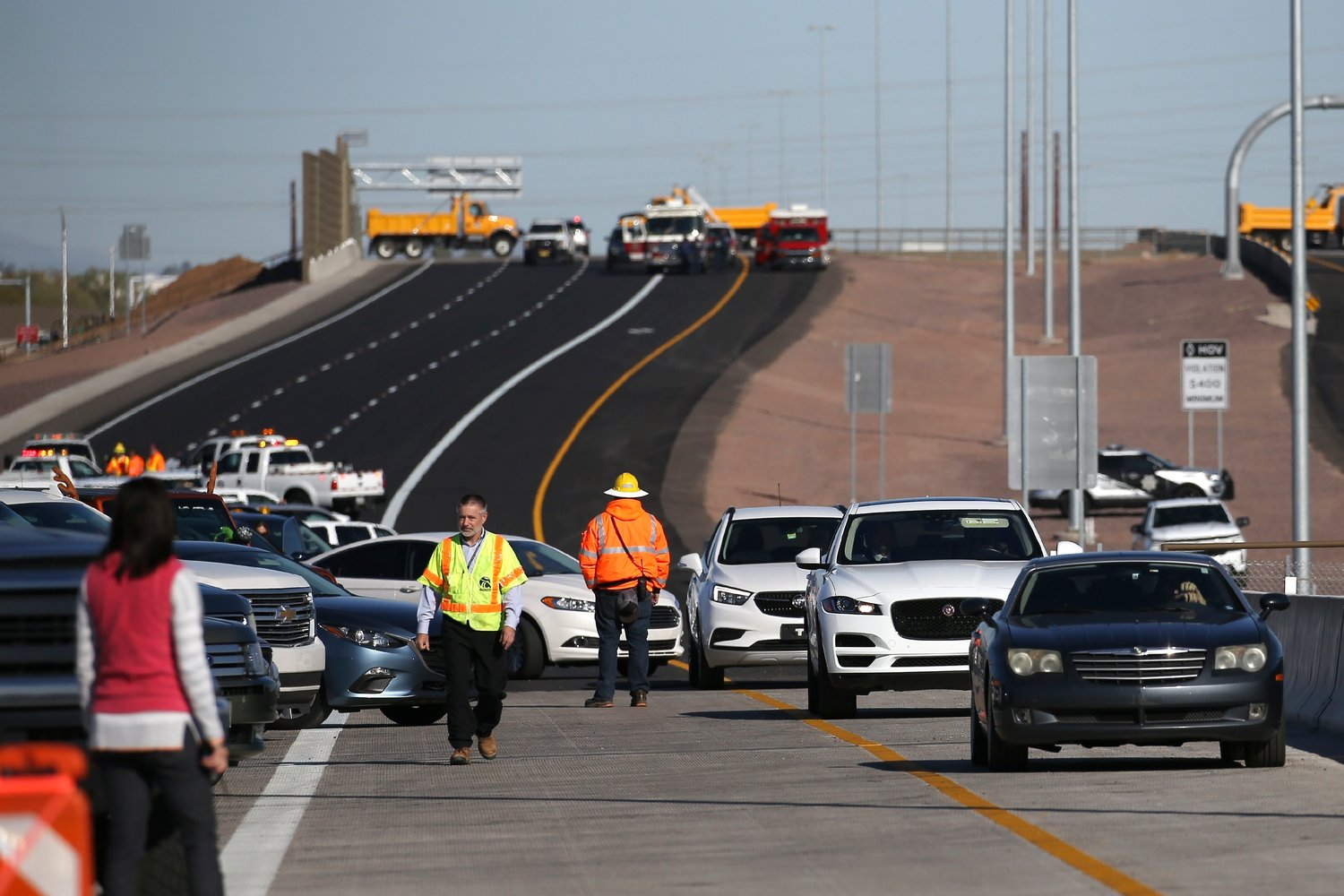 Vehicles drive along the new South Mountain Freeway after a christening event Dec. 18, 2019 in Phoenix. The ceremony comes as construction of the 22-mile $1.7 billion freeway is set to open by the end of the year, and will connect the West and East Valleys of Maricopa County.