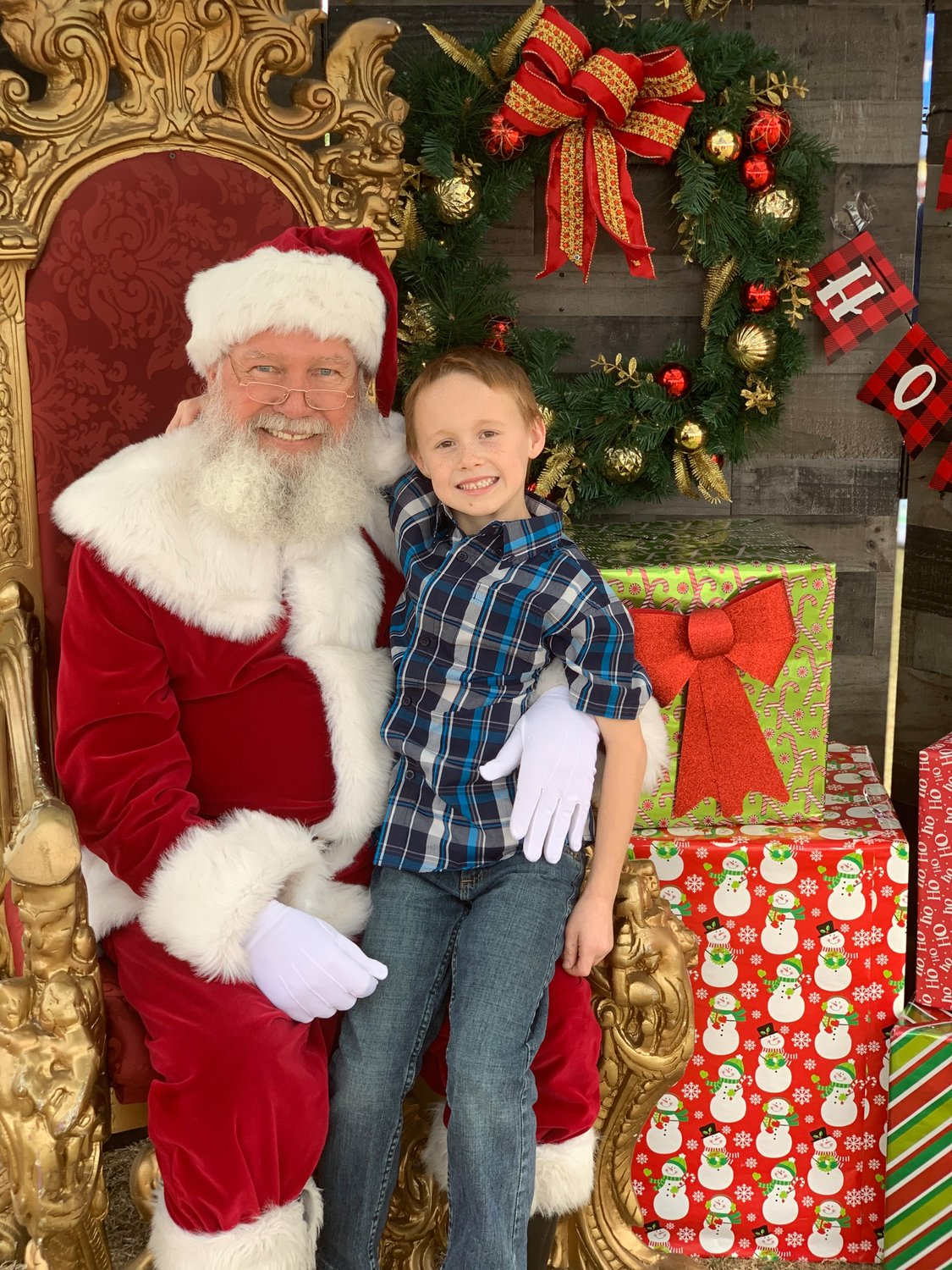 Sterling Whittleton with Santa at the City of Apache Junction's Holiday Event at Flatiron Community Park on Saturday, Dec. 7.