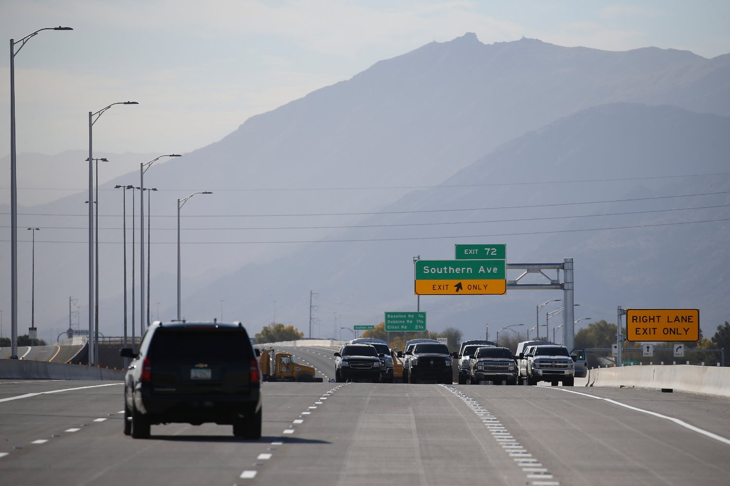 A vehicle with Arizona Gov. Doug Ducey tours the new new South Mountain Freeway after a christening ceremony Dec. 18, 2019 in Phoenix. Since the full opening of the 22-mile freeway on Dec. 21, two wrong-way incidents have been reported, including one fatal.