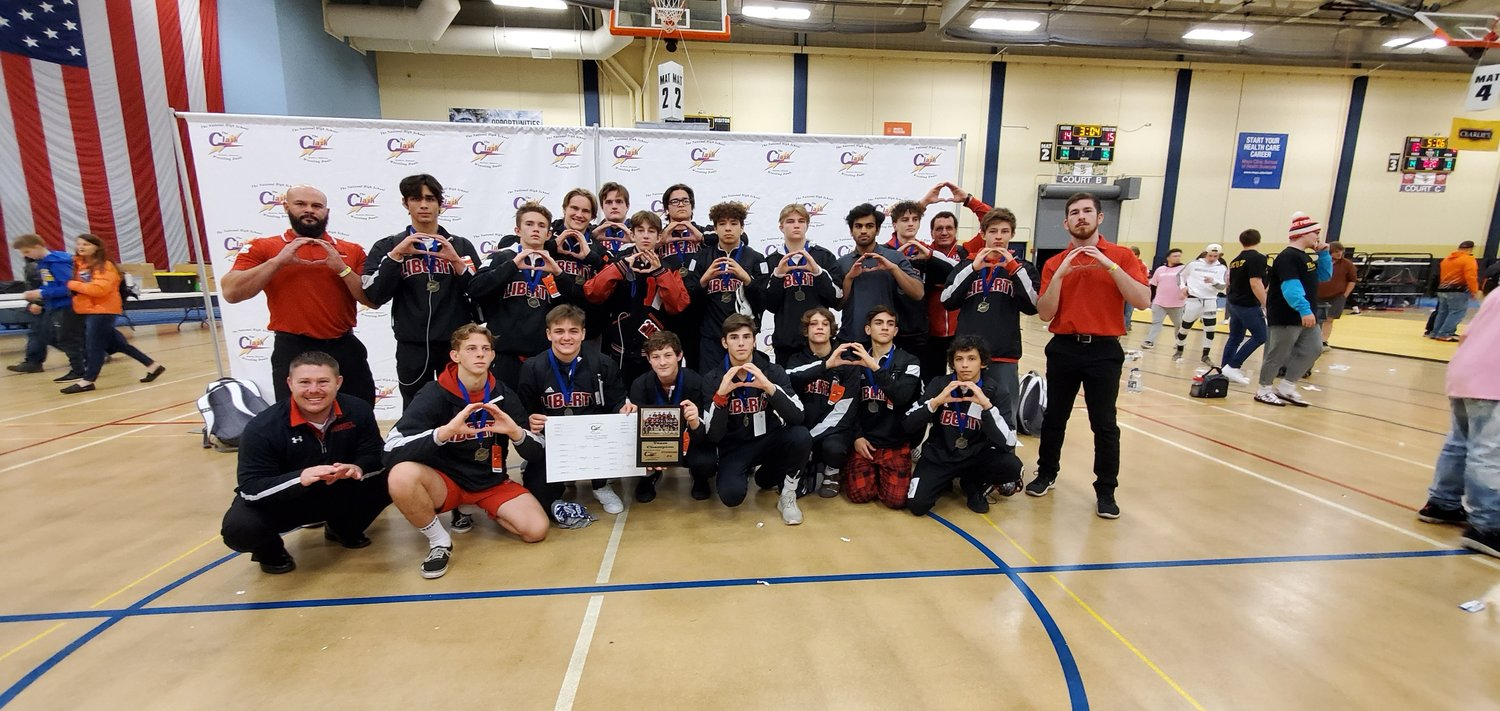 The Liberty wrestling team poses for a photo after winning Division IV of The Clash XVIII tournament in Rochester, Minn. on Jan. 4. That victory placed the Lions 13th overall in the 32-team by invitation duals tournament that brings together some of the top high school teams in the Midwest and nationally.