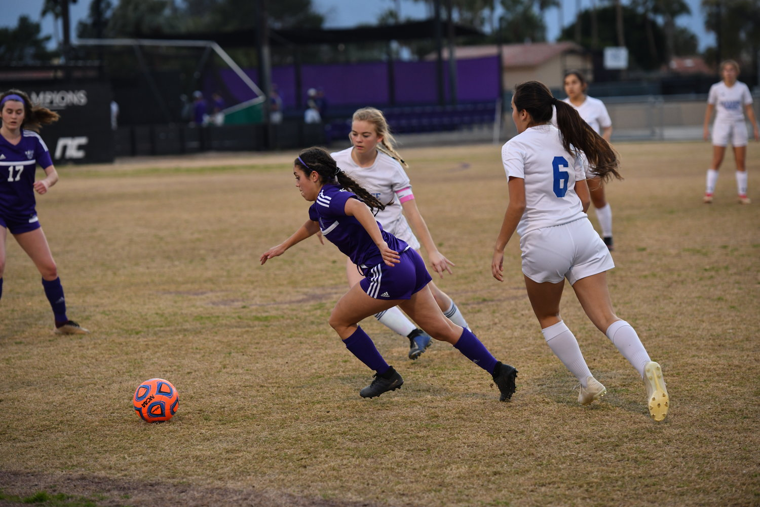 Paradise honors seniors Sierra Sweeney (facing camera) and Helen Grimaldo (#6) defend against Northwest Christian junior midfielder Savanna Ficarra during a 3A game at Northwest Christian School in Phoenix Jan. 9.