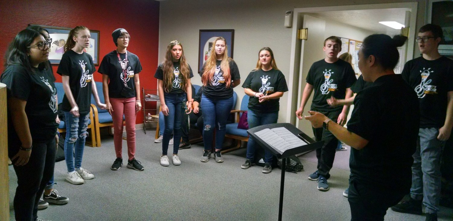 Members of the Apache Junction High School choir in November 2019 serenaded people before an Apache Junction Unified School District Governing Board meeting in a photo from Facebook @ajusd43.