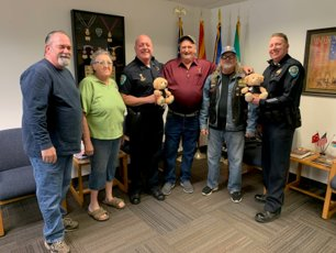 From left are Bob Mayes, Donna Russell, Apache Junction Police Cmdr. Arnold Freeman, Bill Kimball, Bob Blackburn and AJPD Lt. Thom Parker. (Submitted photo)