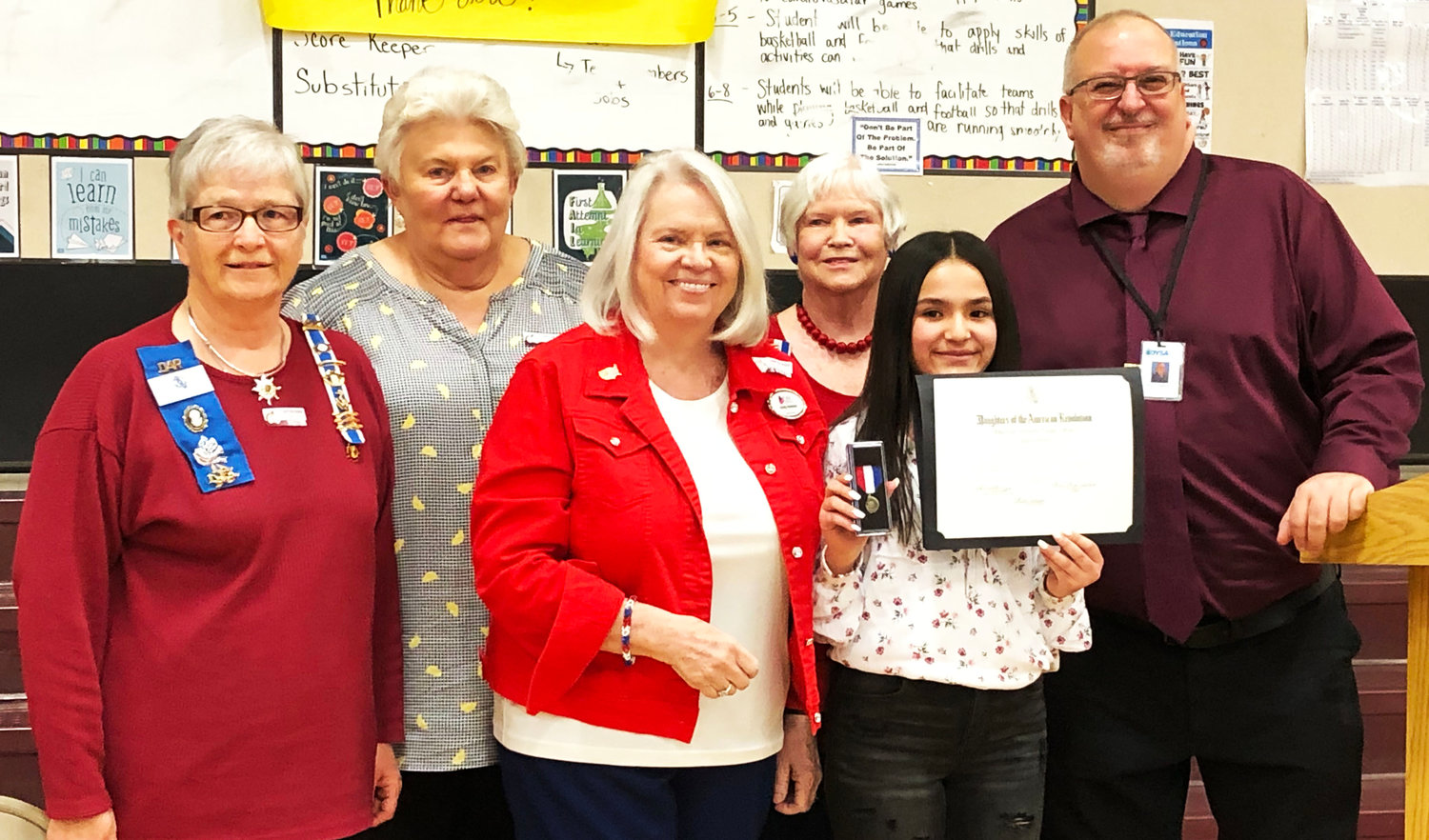 From left, Chapter regent Shirley Staggs, Anita Borski, Chapter chaplain Cynthia Dobbins, Chapter secretary Kathie Mittelsteadt, Chapter winner Mariah Torrez, and 7th grade history teacher Christopher Raso.