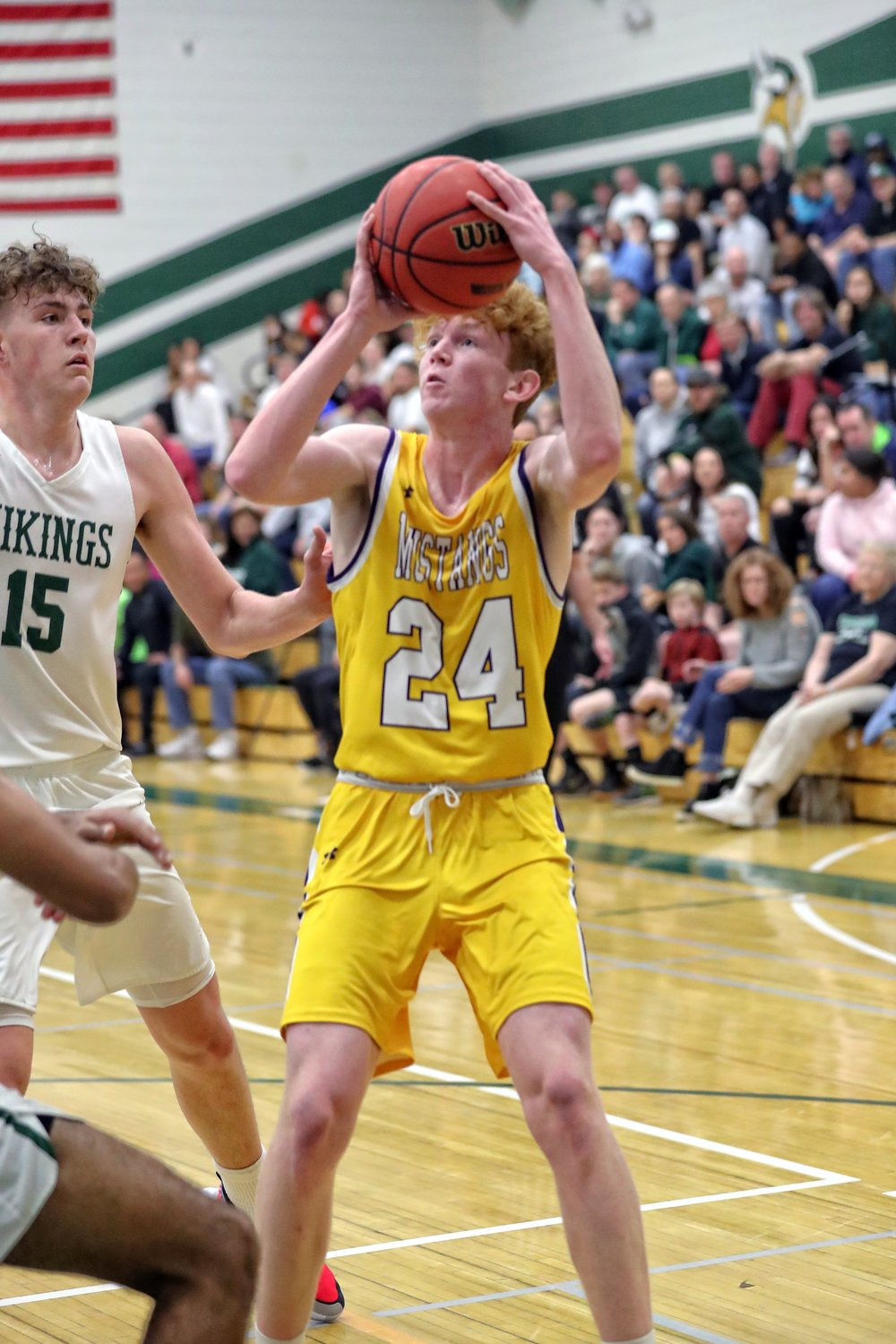 Sunrise Mountain junior forward Colin Carey looks for a baseline jumper while Sunnyslope junior center Carson Basham during a 5A boys basketball first round game Feb. 19 at Sunnyslope High School in Phoenix.
