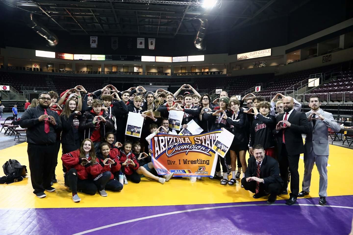 The Liberty boys wrestling team poses Feb. 14 in Prescott Valley after winning its second straight Division I state title. It is the program's third title overall, all within the past five years. [Submitted photo]