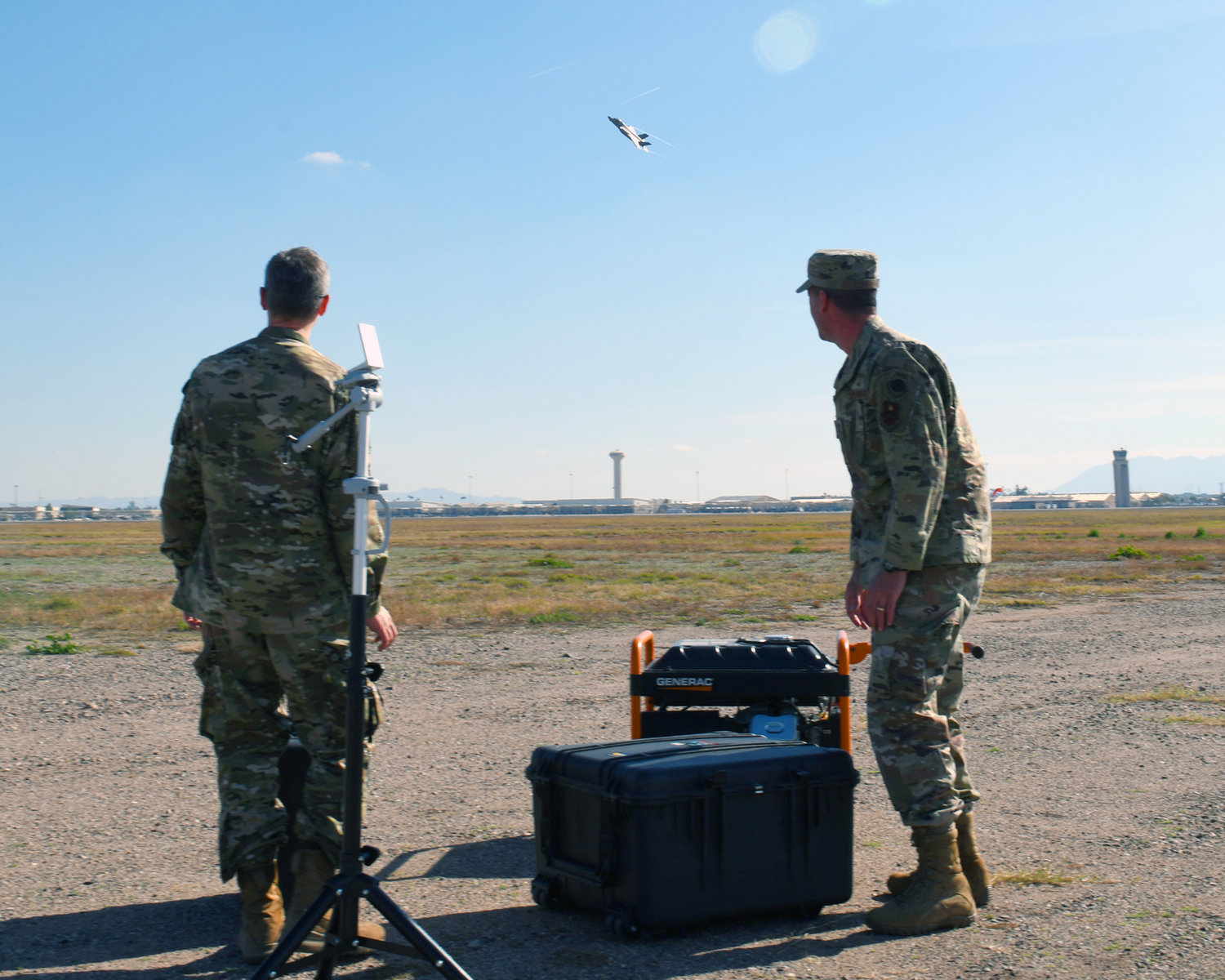 First Lt. Adam Treece, 56th Operations Support Squadron intelligence readiness chief, and Capt. David Coyle, 56th OSS weapons officer, showcase a prototype threat emitter system Jan. 17 at Luke Air Force Base.