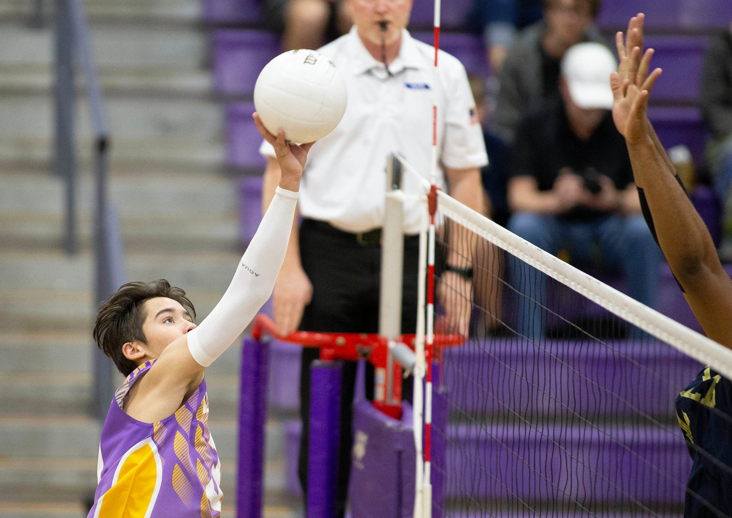 Sunrise Mountain's Hayden Creel hits the ball over the net against Kellis on Tuesday, March 26, 2019 at Sunrise Mountain High School in Peoria.
