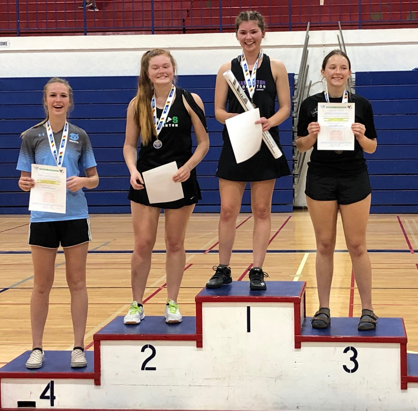 Deer Valley High School senior Sara Roskelley stands on the podium after the 2019 Division II singles championship Oct. 26 at Independence High School in Glendale. She placed fourth.  Badminton is one of the four sports the Skyhawks senior has earned a varsity letter in.