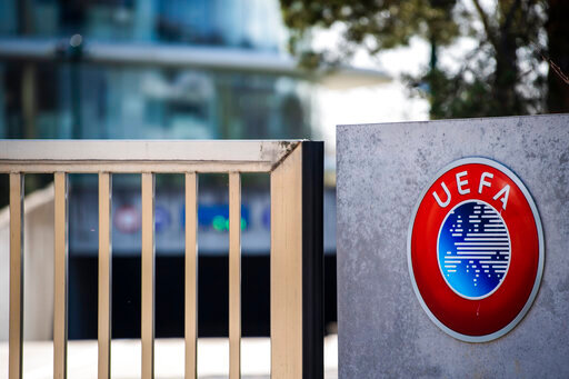 The UEFA logo displayed to the entrance of the UEFA Headquarters, in Nyon, Switzerland, Tuesday, March 17, 2020. The UEFA meet on 17 March 2020 to discuss the effects of the coronavirus pandemic on the UEFA EURO 2020 and the European Cup competitions. For most people, the new coronavirus causes only mild or moderate symptoms, such as fever and cough. For some, especially older adults and people with existing health problems, it can cause more severe illness, including pneumonia. (Jean-Christophe Bott/Keystone via AP)