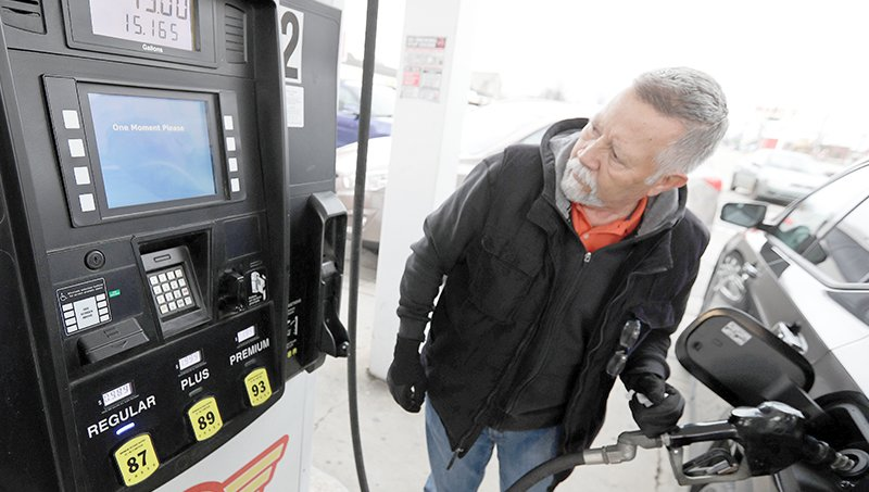Julio DeJesus pumps gas for 98.9 cents a gallon March 30, 2020 in Cleveland. Oil started the year above $60 per barrel and has plunged on expectations that a weakened economy will burn less fuel. Over the past month, the average gasoline price has dropped by 20% nationally, while in Arizona, lower demand has helped reduce the price at the pump by 15%. [The Associated Press]