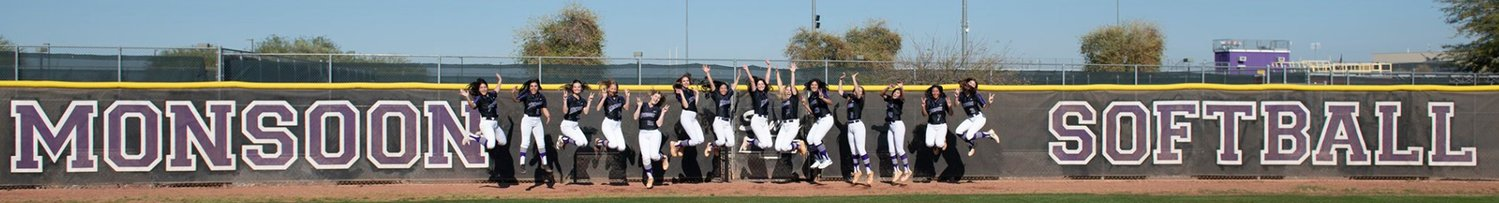 The Valley Vista softball team jumps for joy next to its outfield fence during a preseason photo shoot. The program, with its fifth different head coach in five years, played 11 games until the season was called for all spring sports amidst the coronavirus outbreak.
