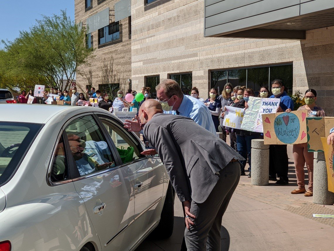 Physicians and staff greeted them with signs while wearing face masks and practicing social distancing.