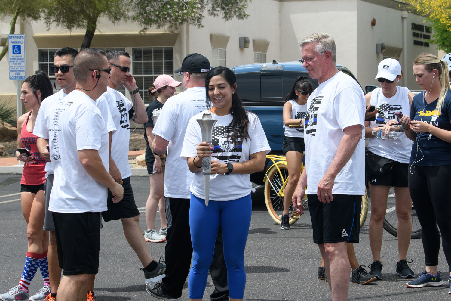 Detective Jenny Rubio holds the torch during APD's 2019 event. It was her idea to hold a virtual run when COVID-19 concerns canceled the 2020 event.