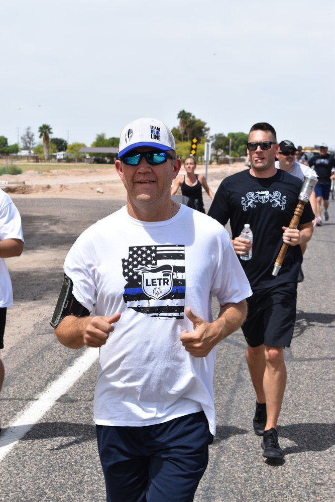 Police Officer Robert Igo, front, and Sgt. Ryan McCarthy keep the pace during Goodyear Police Department's leg of 2019 torch run.