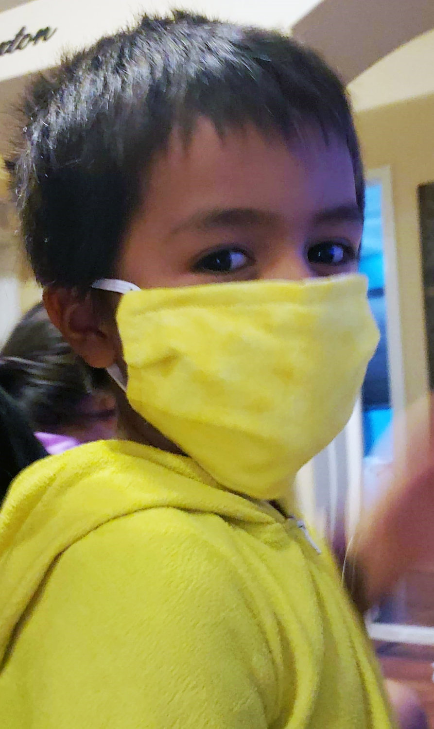 A Navajo child wears a mask donated by the Litchfield Greens neighbors.