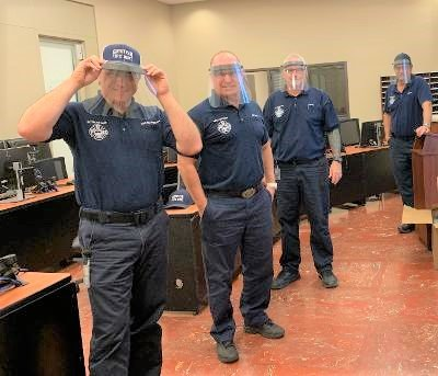 Goodyear Fire Department personnel try on face shields donation by Rotary Club of Goodyear PebbleCreek.