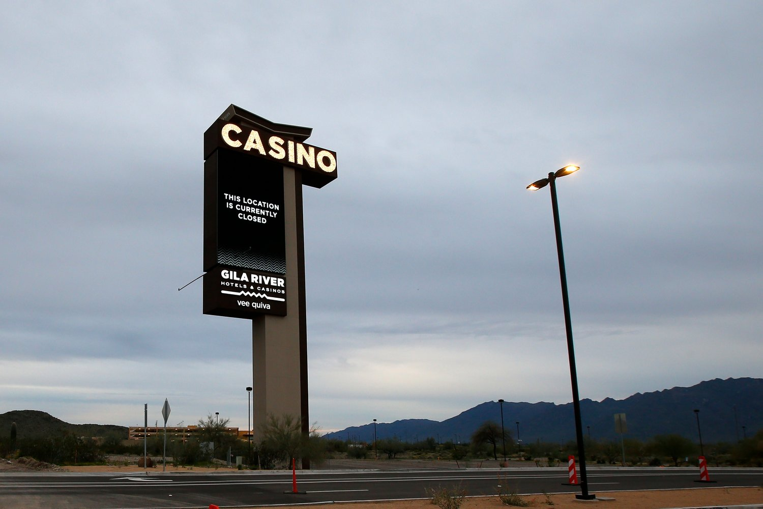A sign shows the Gila River Hotels & Casinos Vee Quiva location closed due to the coronavirus Friday, March 20, 2020, in Laveen, Arizona.