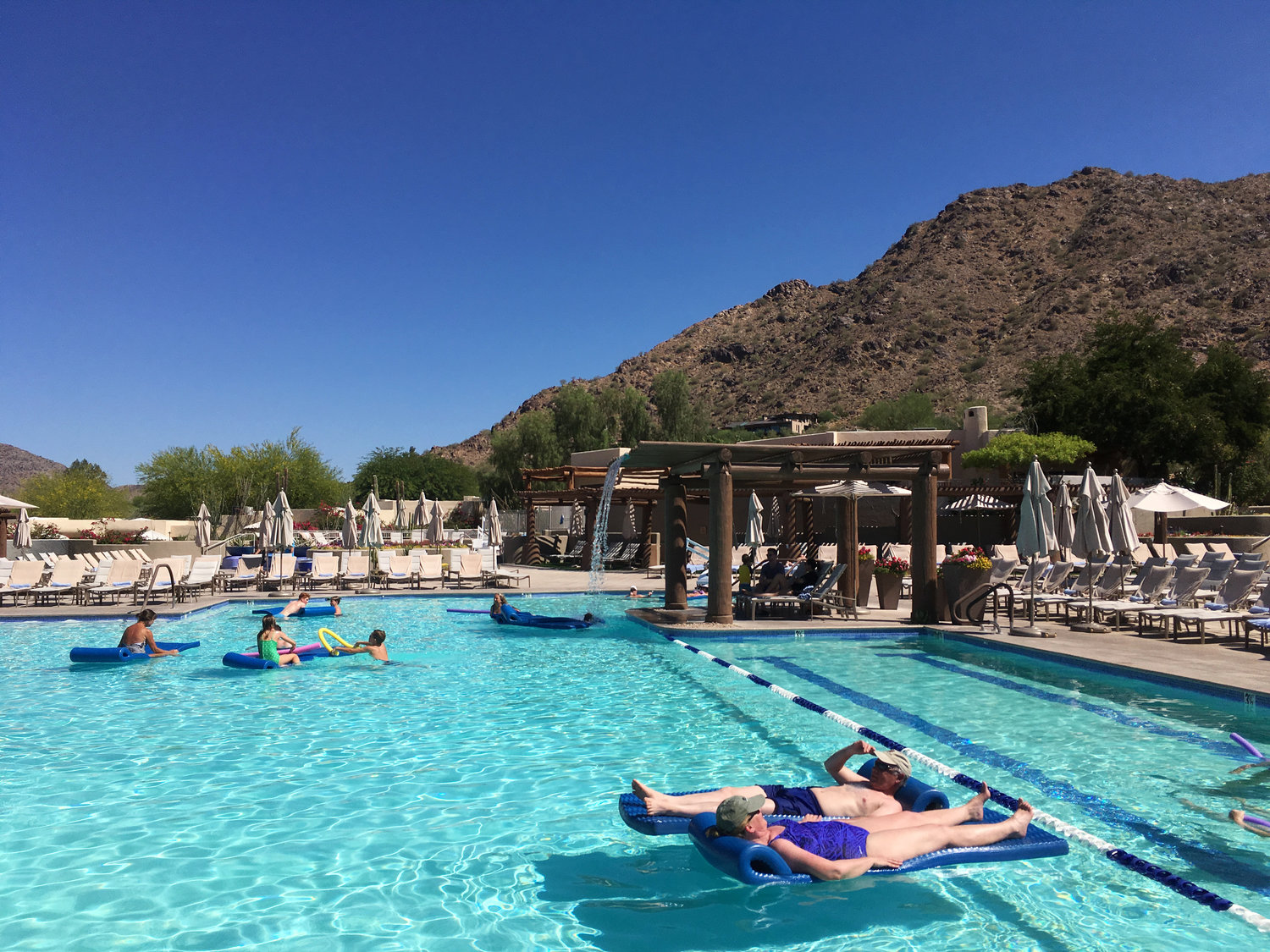 Hotel guests cool off at the pool at the JW Marriott Scottsdale Camelback Inn Resort and Spa in Paradise Valley on Sunday, June 19, 2016.