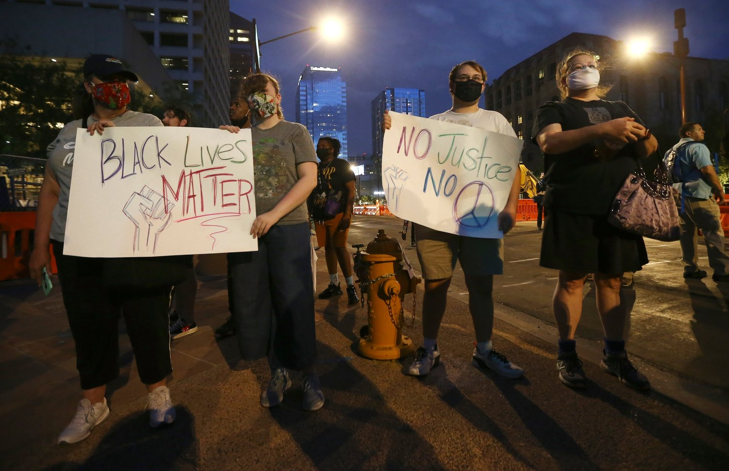 Protesters gather in front of Phoenix City Hall, Saturday, May 30, 2020, in Phoenix while protesting the death of George Floyd, a handcuffed black man who died in Minneapolis police custody on May 25.