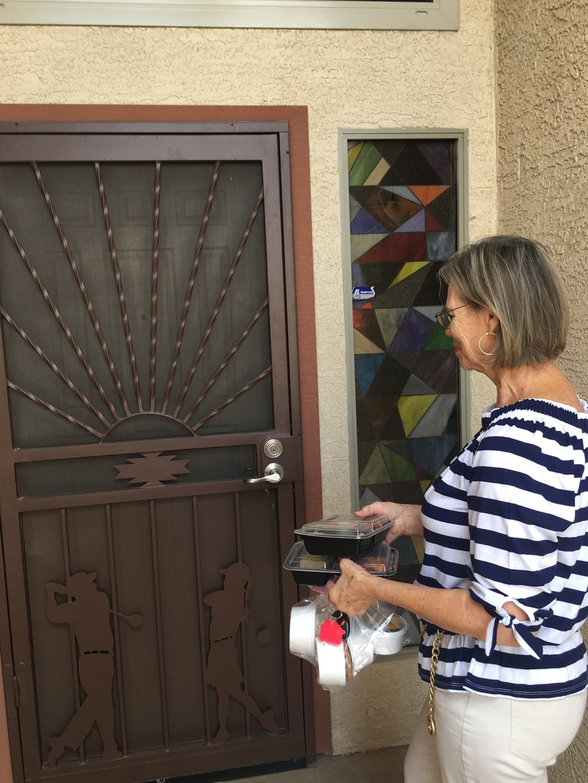 A Meals of Joy volunteer prepares to deliver meals to a West Valley senior. Funds raised through the Duck Derby support the meal delivery program.
