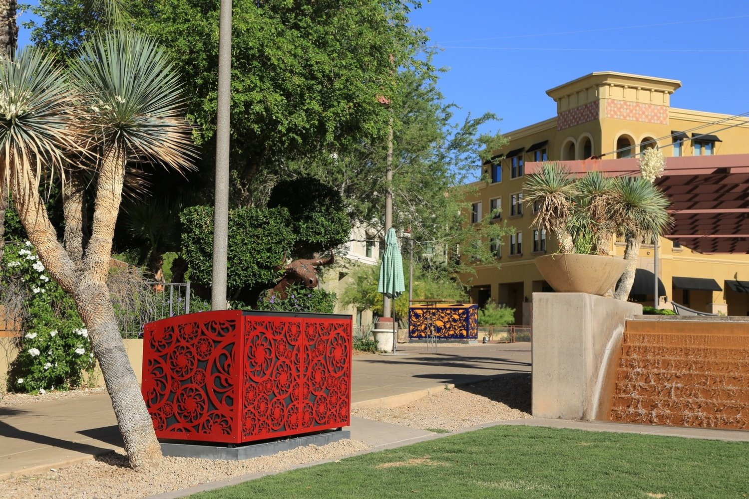 "Chandler artist Mary Neubauer designed ""Traceries,"" a series of eight recycle/trash bins installed along the Scottsdale Waterfront in May."
