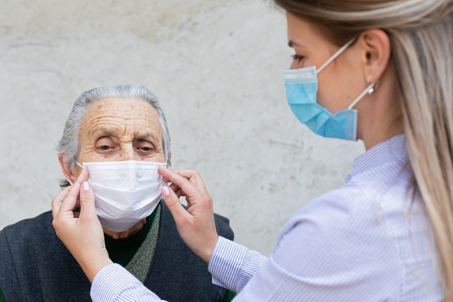 Caregivers are at risk of catching COVID-19 or spreading the virus to their families, as they work closely with elderly residents.