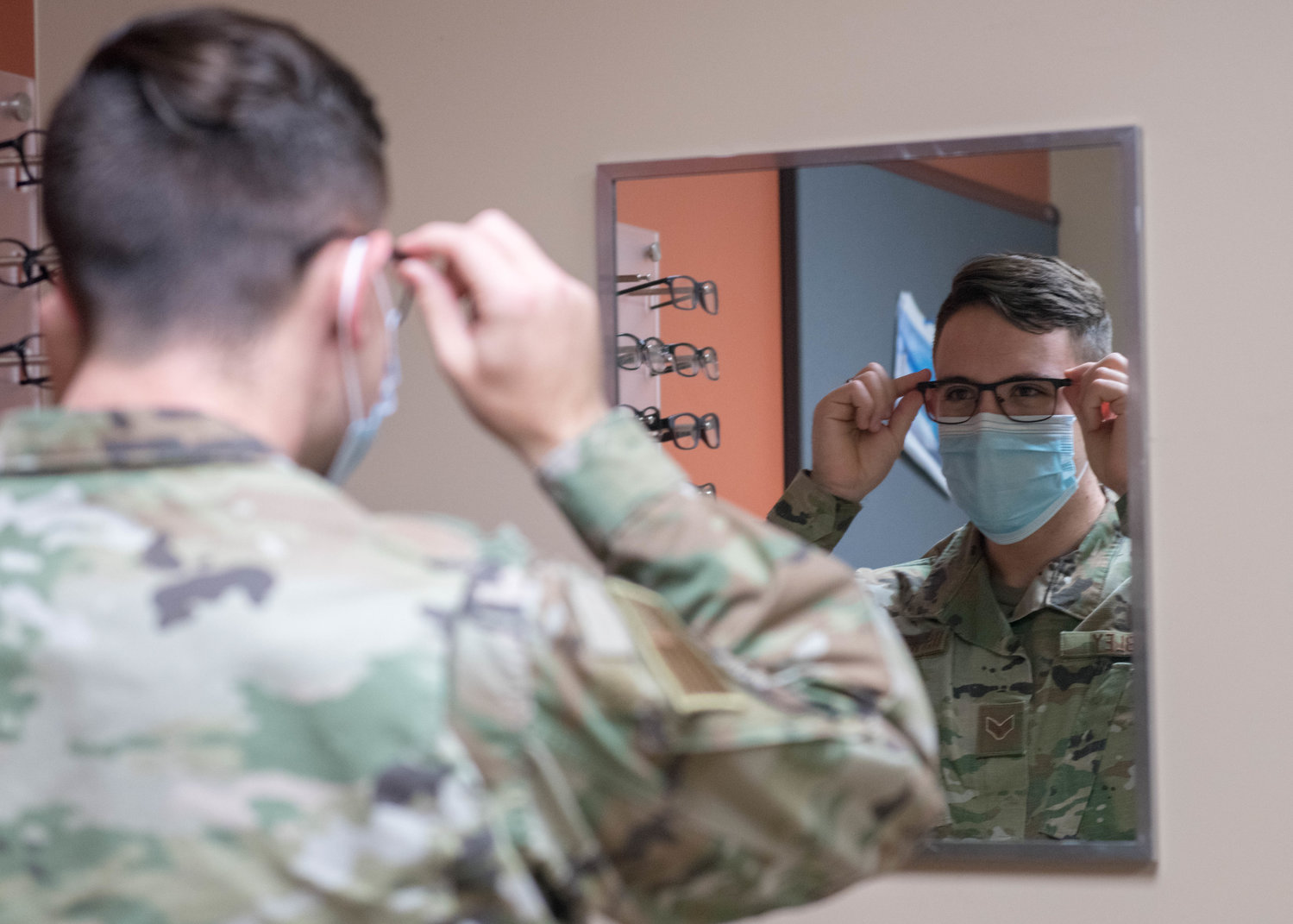 Senior Airman Troy Dibley, 61st Fighter Squadron F-35A Lightning II avionics journeyman, tries on a pair of prescription glasses June 9, 2020, at Luke Air Force Base. The Luke Optometry clinic provides a choice of more than 50 styles of customized and standard frames.