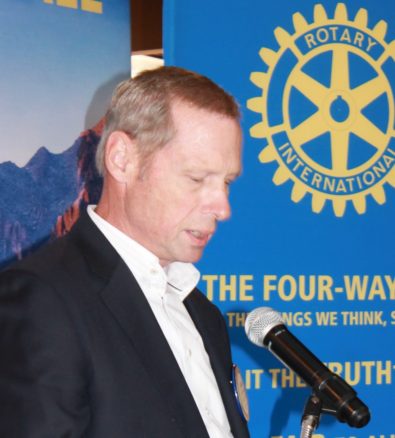 Rotary Club of Scottsdale's Scholarship Committee Chair Gary Chontos announces scholarship interview dates at a club meeting held earlier this year.