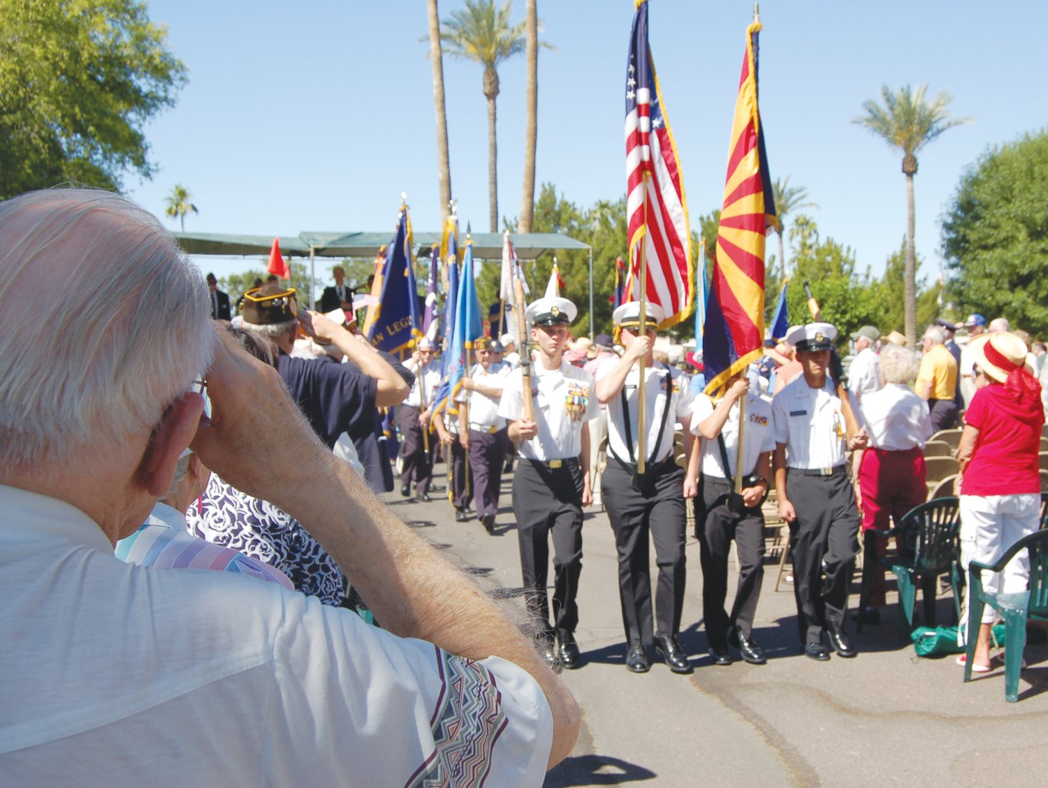 A veteran shows his respect and love of his country as the color guard passes during a Veterans Day ceremony in Sun City.