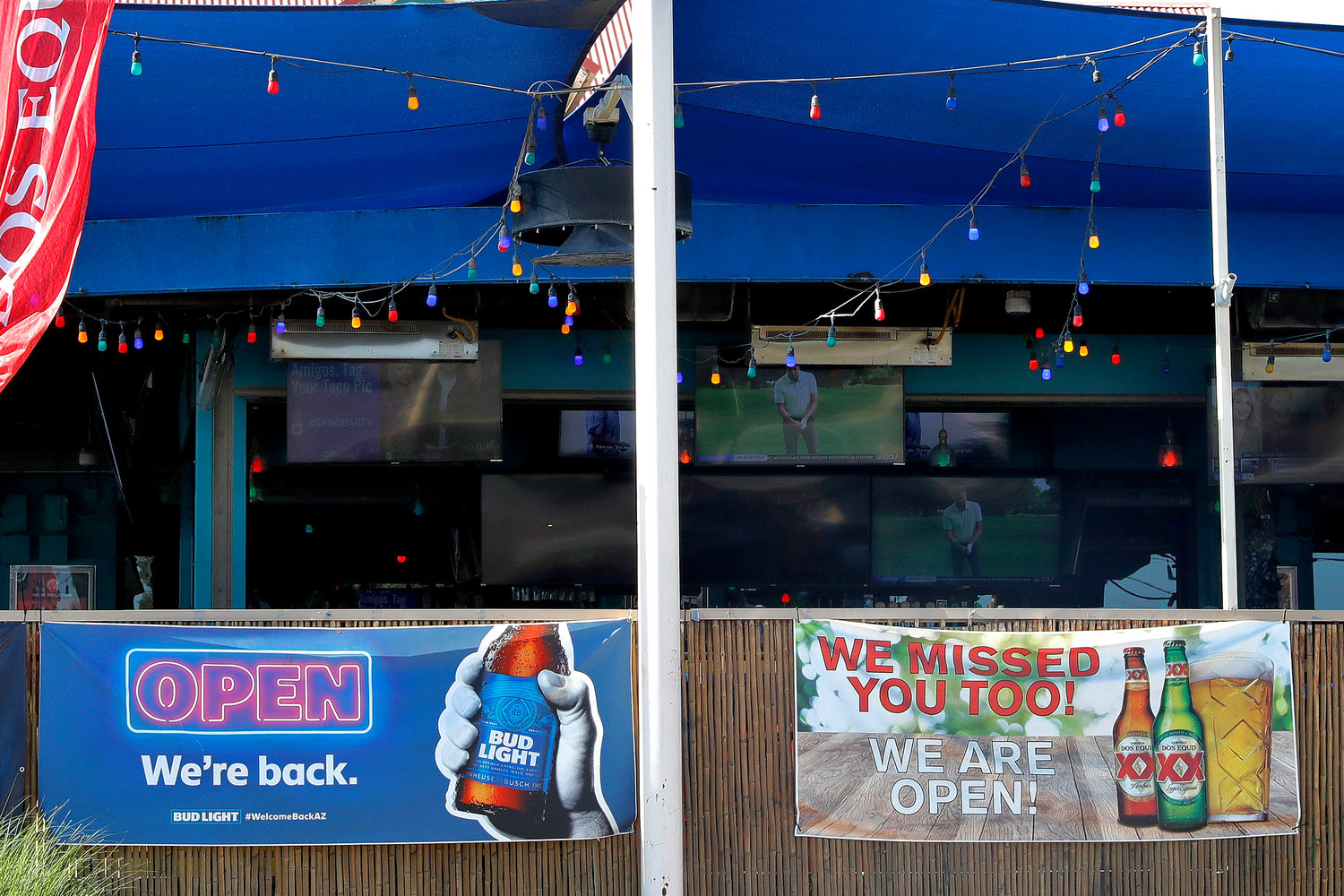A sports bar is empty before it closed early Monday, June 29, 2020, in Phoenix. Arizona Gov. Doug Ducey shut down bars, movie theaters, gyms and water parks amid a dramatic resurgence of coronavirus cases.