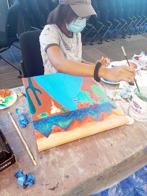 A participant in Catitude Gallery & Studio's Follow Your Art Jr program works on her painting. The organization was one of 21 organizations awarded grants by the city of Goodyear.