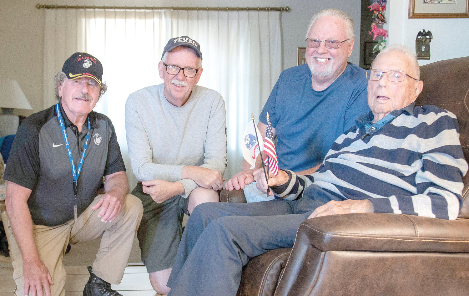 Hospice of the Valley volunteer Rodney Dehmer meets with Tom and Jim Dorr and their father, World War II veteran Chester Dorr, who was honored on the 75th anniversary of D-Day. Their meeting came before the coronavirus outbreak; hospice volunteers now visit with veterans remotely via video. [Courtesy of Hospice of the Valley]