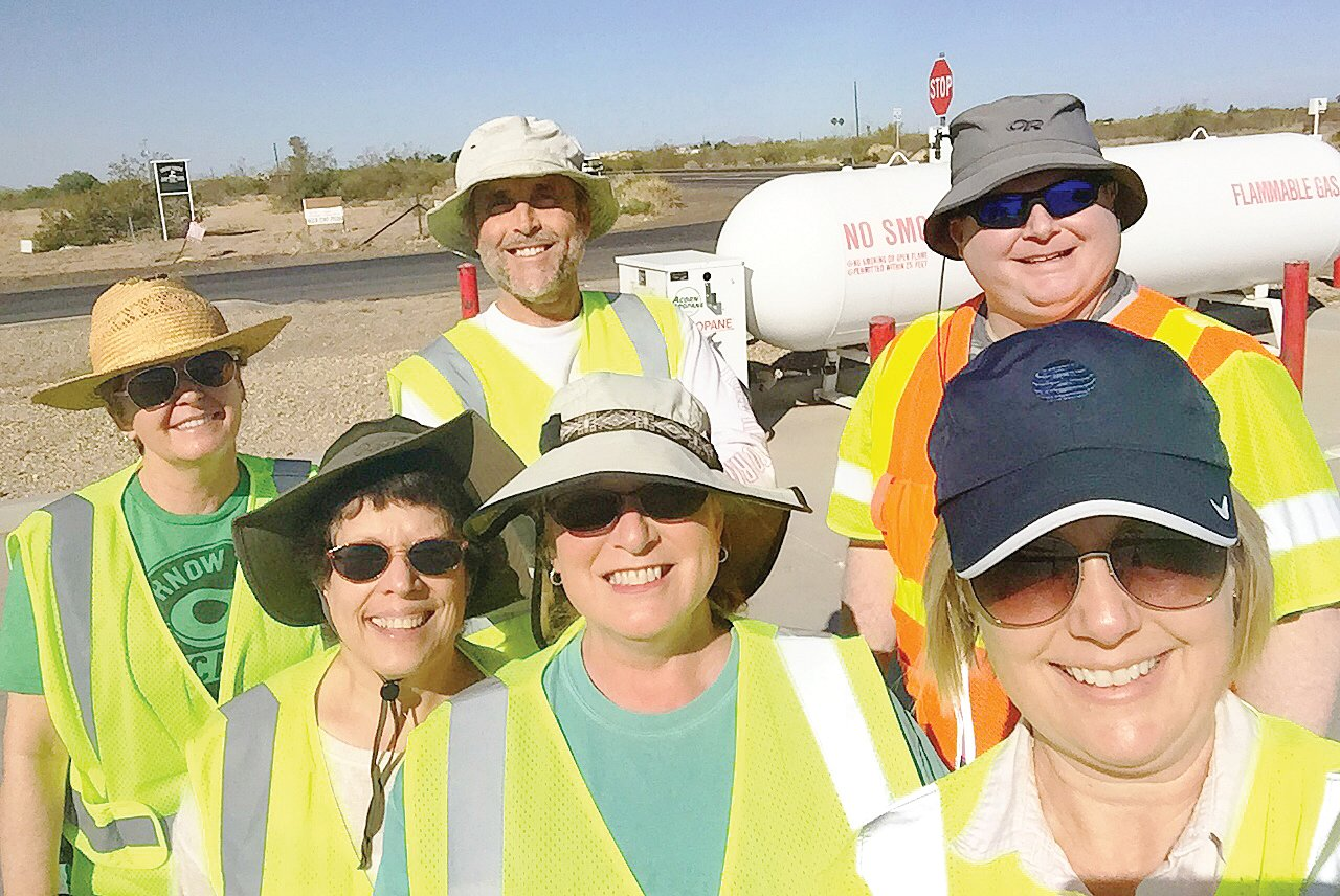 In this 2019 file photo, Arizona Department of Transportation Adopt a Highway Program Manager Mary Currie, right, poses with volunteers. Transportation officials are touting the upcoming National CleanUp Day slated for Saturday, Sept. 19. [Courtesy of ADOT]