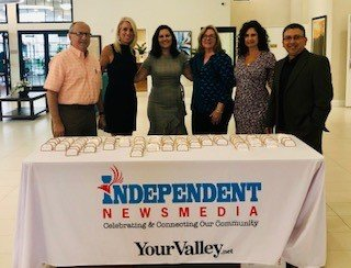 Independent Newsmedia team members wait to greet guests at the Surprise Hometown Heroes Awards in 2019.