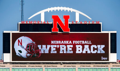 Memorial Stadium's north stadium video board projects the news of the return of Big Ten NCAA college football, Wednesday, Sept. 16, 2020, in Lincoln, Neb. Less than five weeks after pushing fall sports to spring in the name of player safety during the pandemic, the Big Ten conference changed course Wednesday and said it plans to open its football season the weekend of Oct. 23-24. (Francis Gardler/Lincoln Journal Star via AP)