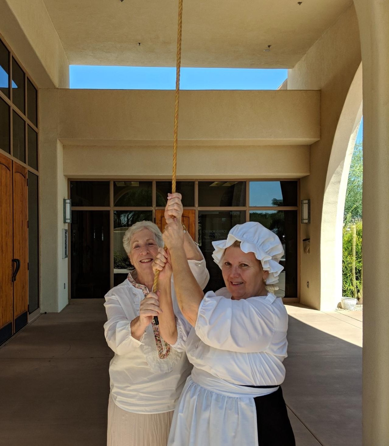 Jill Bills and Joan Brown ringing the bell at the Gold Canyon Methodist Church last year during Constitution Week.